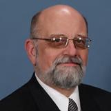 Dr. Kent Moors