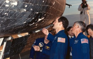 STS-27 crew viewing shuttle after landing