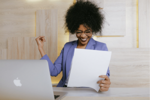 woman excited with white paper